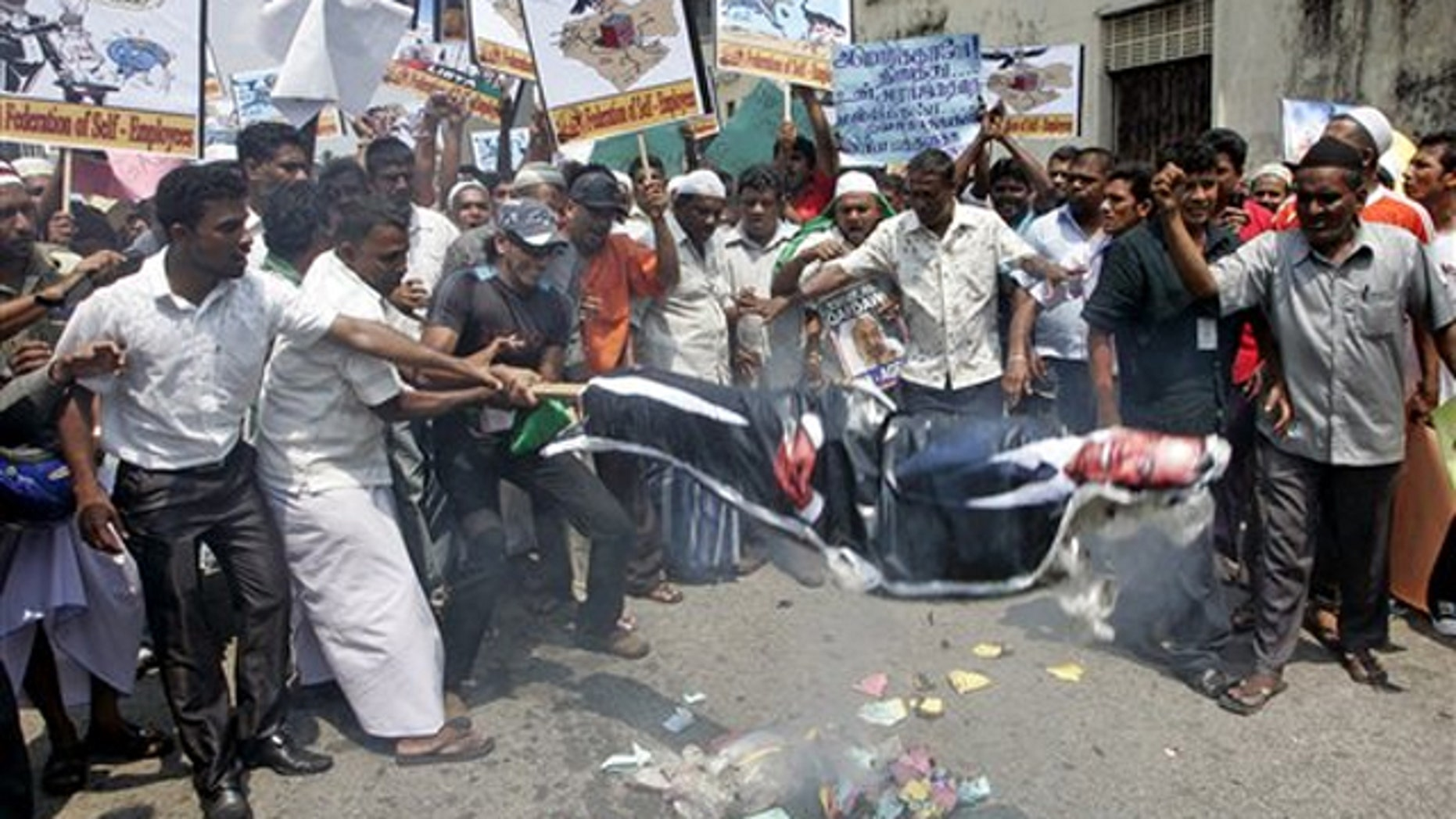 Sri Lankan Muslims burn an effigy of President Obama during a protest rally against the allied forces' air strike in Libya, in Colombo, Sri Lanka, March 25.