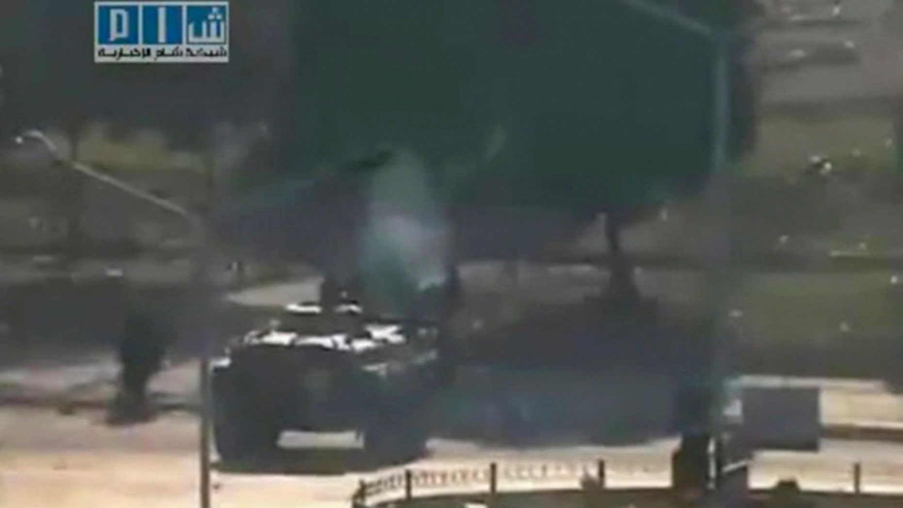 Aug. 3: This image posted on the Internet by Shaam News Network, showing what they purport to be a military tank on the streets of the city of Hama, Syria, on the 'third day of Ramadan'. Gunmen in plainclothes are randomly shooting people in the streets of the besieged Syrian city of Hama and families are burying their loved ones in gardens at home for fear of being killed themselves if they venture out to cemeteries, a resident said Thursday, Aug. 4, 2011.
