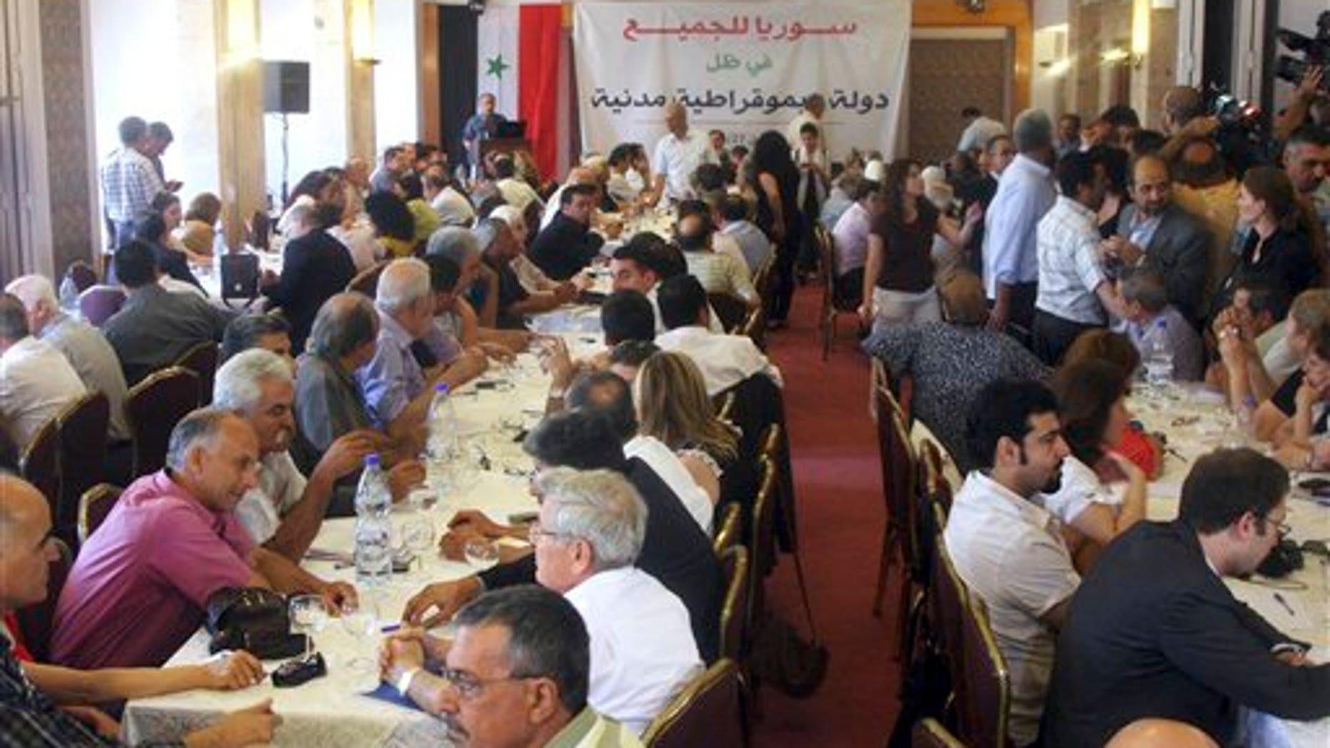 "June 27: Prominent opposition figures and critics of Syrian President Bashar Assad's regime gather for a meeting in Damascus, Syria. Nearly 200 critics of President Bashar Assad met Monday in the Syrian capital for the first time during the three-month uprising against his rule, in a government-sanctioned gathering some activists complained would be exploited to give legitimacy to the regime. The attached banner in Arabic reads ""Syria is for everybody, in the shadow of a democratic civil state."""