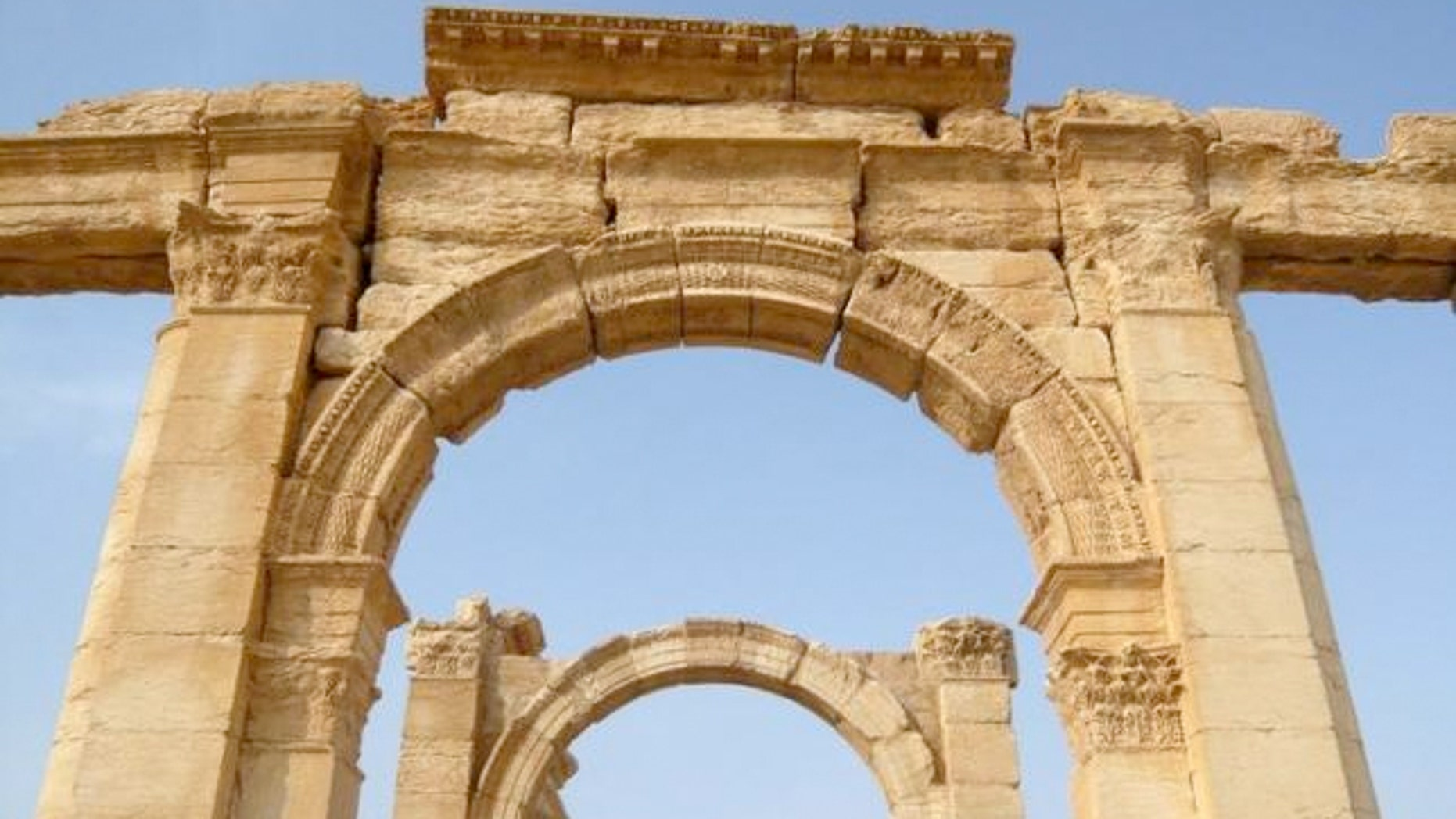 FILE: A view shows the Monumental Arch in the historical city of Palmyra, Syria, August 5, 2010.  In Oct., ISIS blew up the monument, which is in the 2,000-year-old city of Palmyra.