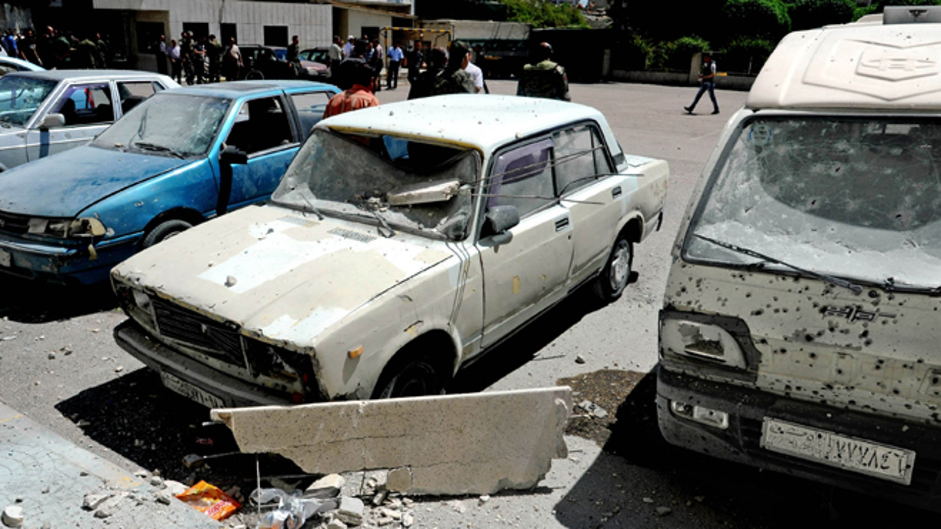 April 29, 2014: In this photo which AP obtained from the Syrian official news agency SANA, and has been authenticated based on its contents and other AP reporting, damages are seen after a series of mortar shells hit Damascus, killing more than a dozen people and wounding scores in Syria.