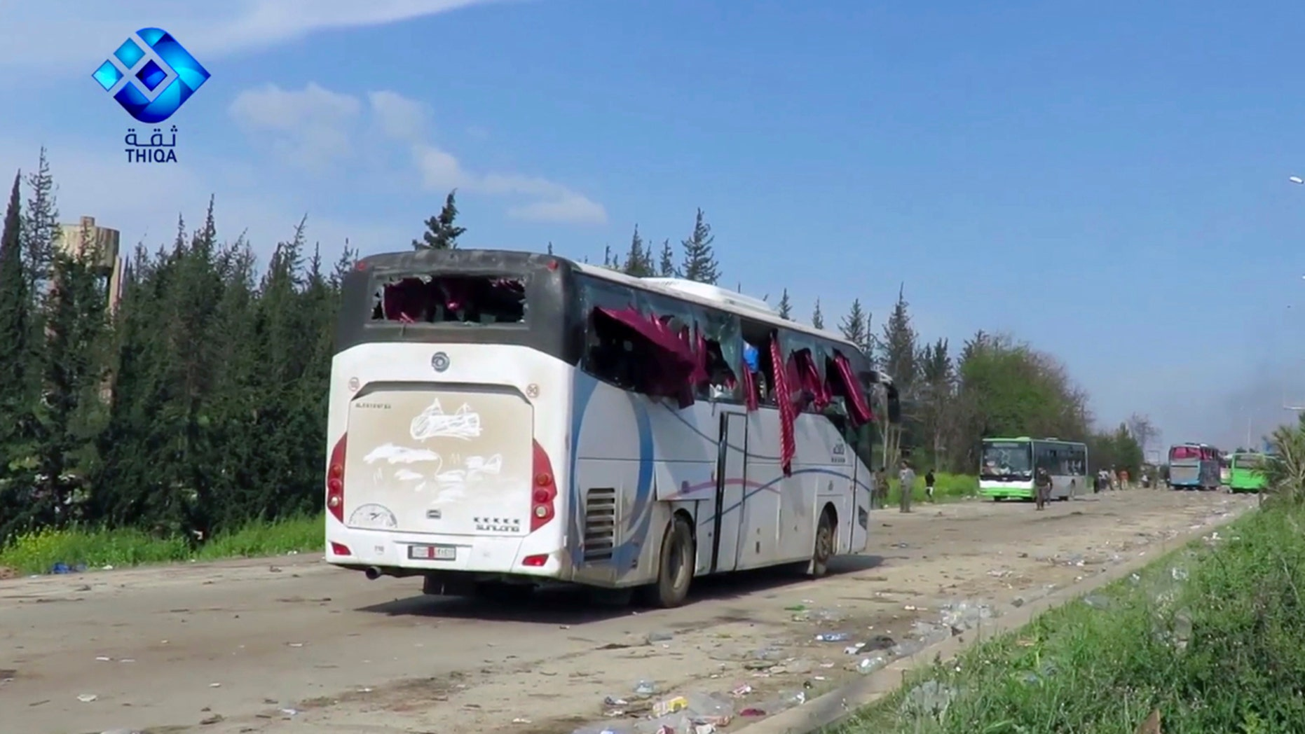 This frame grab from video provided by the Thiqa News Agency, shows buses damaged by a blast at the Rashideen area, a rebel-controlled district outside Aleppo city, Syria, Saturday, April. 15, 2017