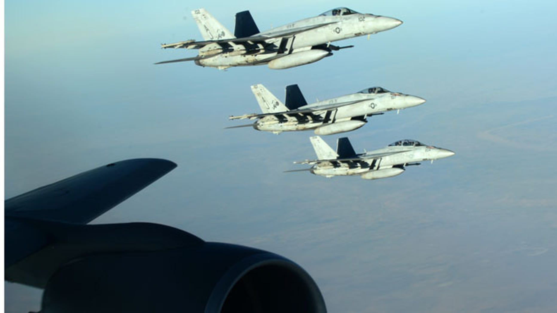 Sept. 23, 2014: In this photo released by the U.S. Air Force, a formation of U.S. Navy F-18E Super Hornets leaves after receiving fuel from a KC-135 Stratotanker over northern Iraq as part of U.S. led coalition airstrikes on the Islamic State group and other targets in Syria. (AP)