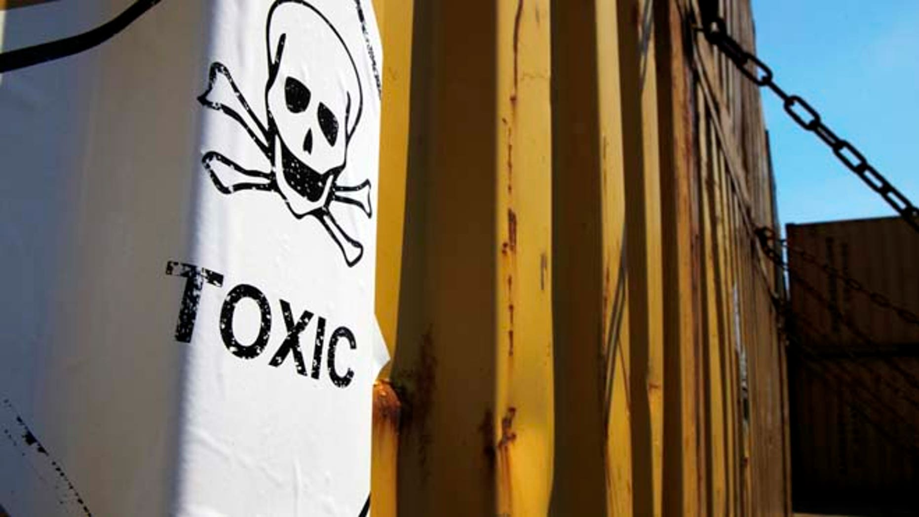 """May 13, 2014: A sticker reading """"Toxic"""" on containers carrying Syria's dangerous chemical weapons, on the Danish cargo ship, Ark Futura, transporting the chemical weapons out of the strife-torn country, in Cyprus coastal waters. (AP)"""