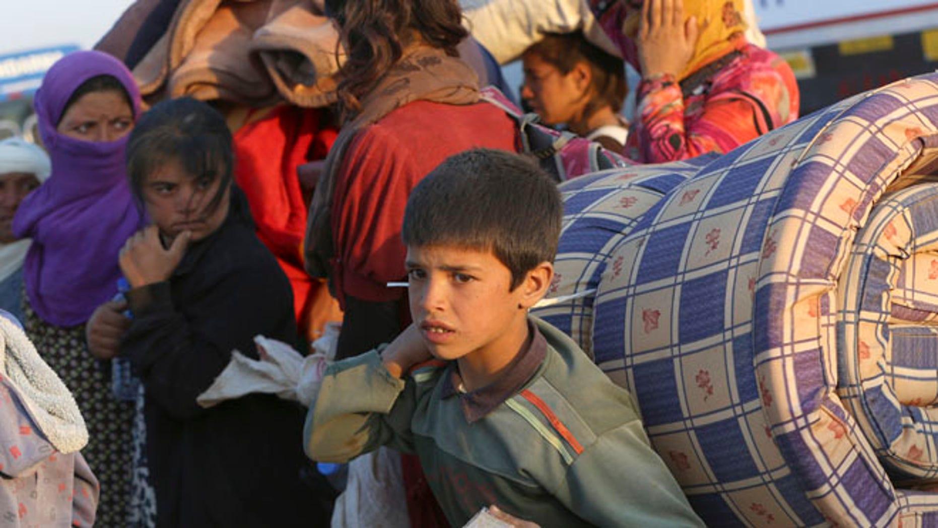 Sept. 23, 2014: Thousands of Syrian refugees enter Turkey at Yumurtalik crossing gate near Suruc