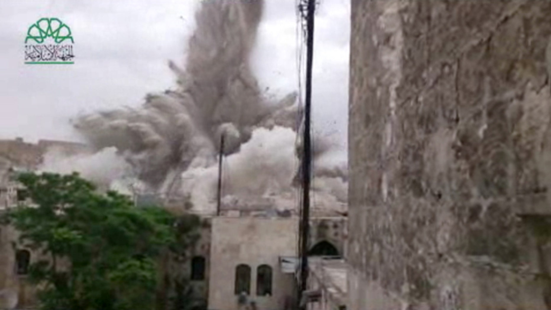 May 8, 2014: This image made from amateur video posted by Shaam News Network (SNN), an anti-Bashar Assad activist group, which has been verified and is consistent with other AP reporting, shows an explosion that destroyed the Carlton Hotel in Aleppo, Syria.