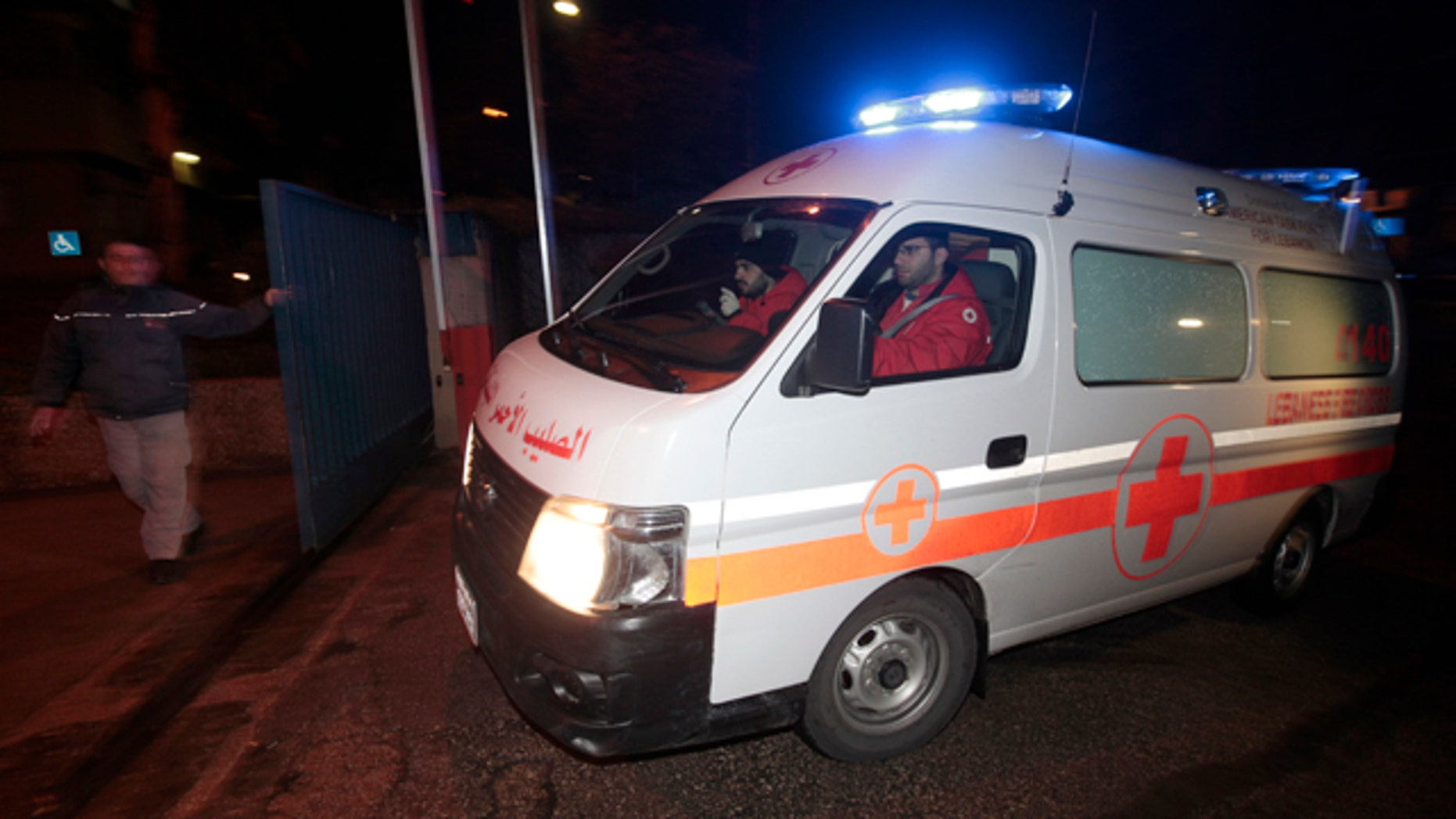 March 2, 2012: A Lebanese Red Cross ambulance follows Lebanese police vehicles carrying two injured French journalists who were trapped at Baba Amr neighborhood in Homs province after they were wounded by the Syrian government forces shelling, to enter the hospital of Hotel Dieu, in Beirut, Lebanon.