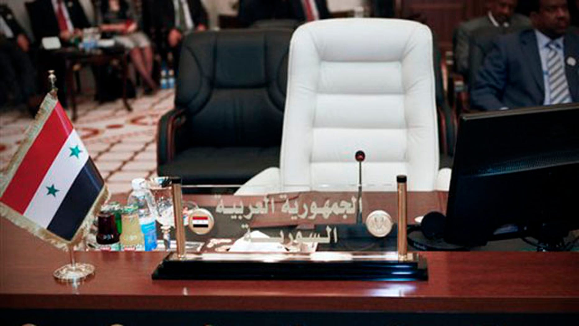 March 28,2012: The empty seat of the Syrian Foreign Minister is seen during the meeting of Arab Foreign Ministers in Baghdad, Iraq.