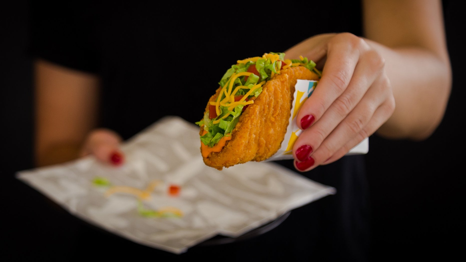 Taco Bell is bringing back its Naked Chicken Chalupas, with a fried chicken shell, and an even spicier version.