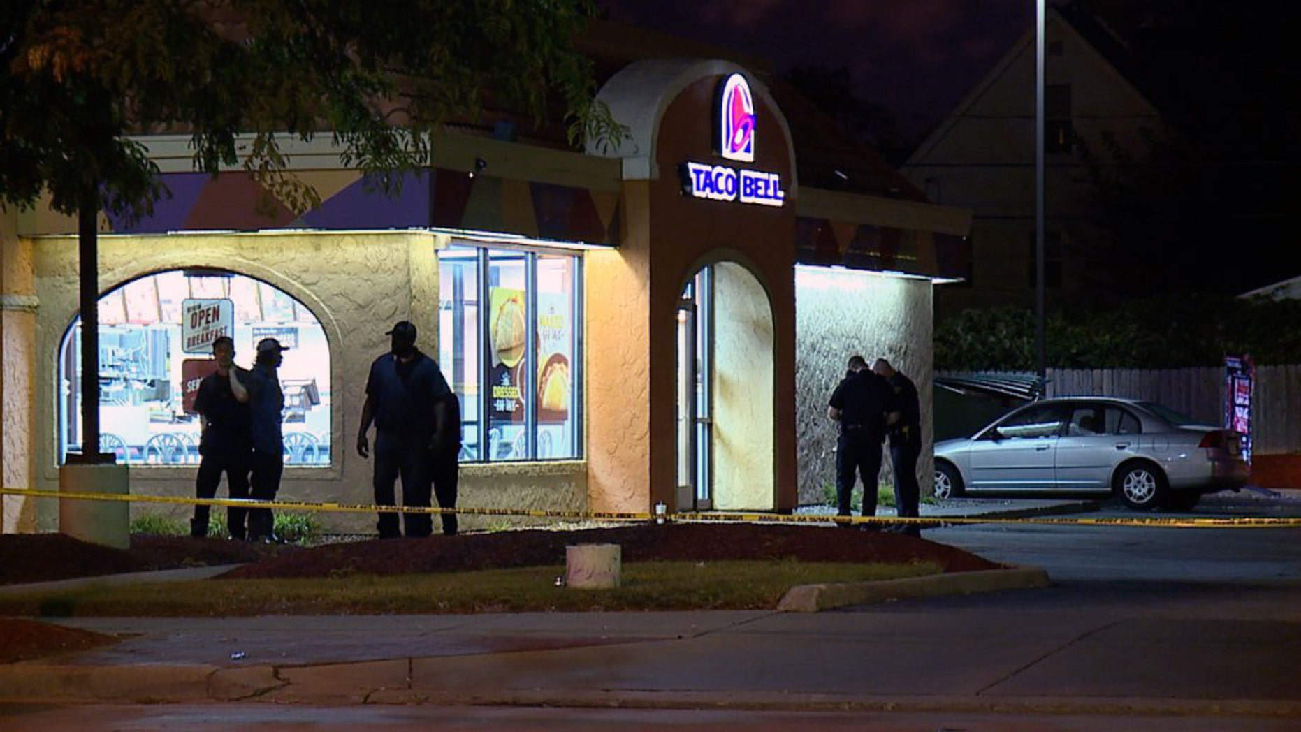 Cleveland Police respond to the Taco Bell after a would-be robber was shot and killed by employees