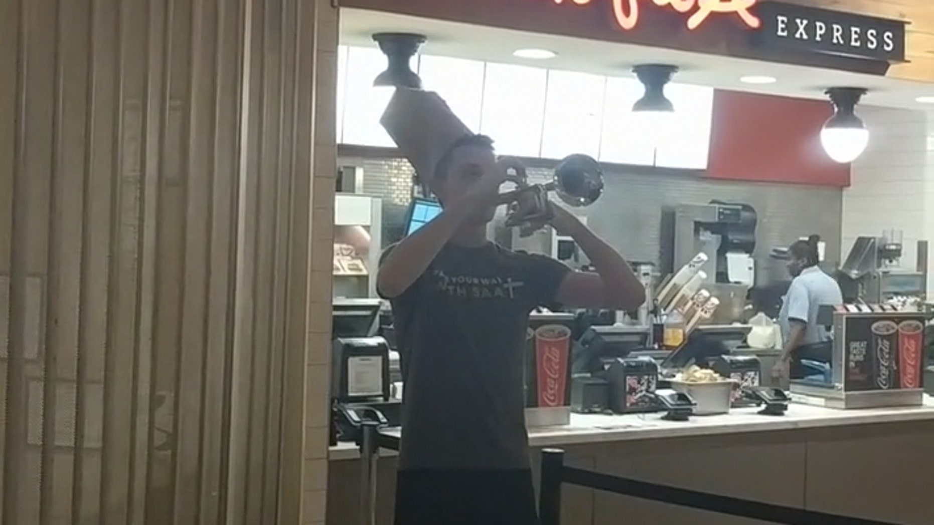 A young man played a rendition of taps in honor of the Taco Bell that closed on Georgia Tech's campus last week.