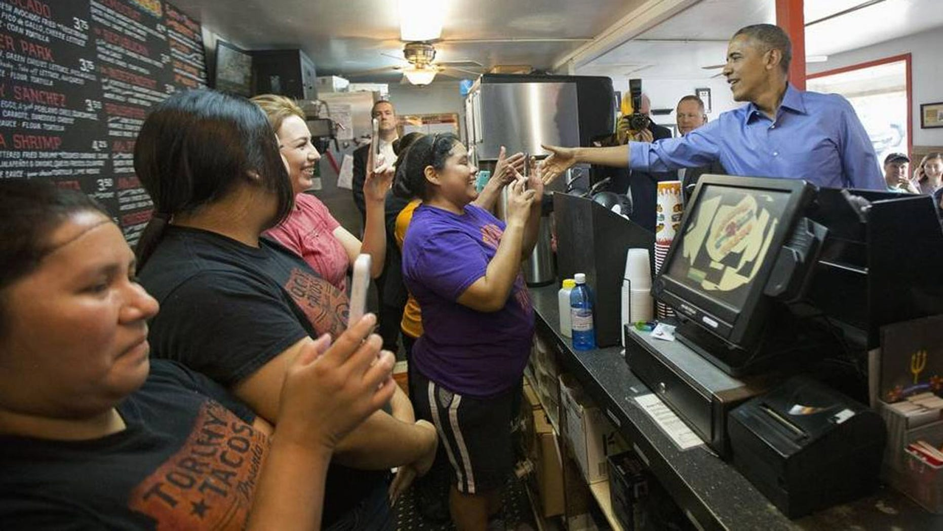 President Barack Obama greets employees during an unannounced stop at Torchy's Tacos in Austin on Friday. There are several Torchy's in North Texas. Obama traveled to Austin, to speak at SXSW.