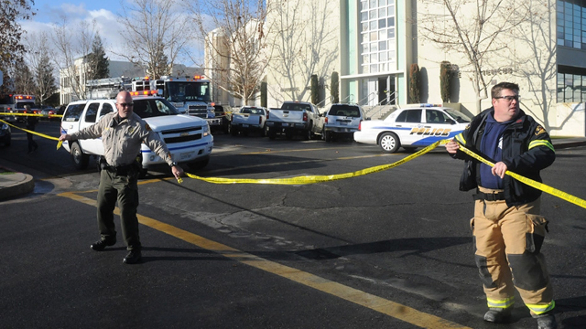 Jan. 10, 2013: This image shows officials taping off an area outside San Joaquin Valley high school in Taft, Calif.
