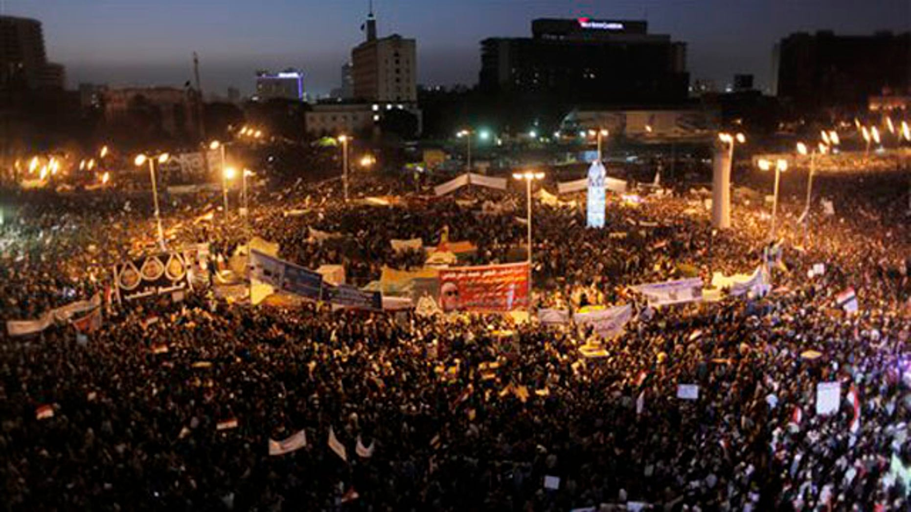 Jan. 25, 2012: Protesters fill Tahrir Square after sundown in Cairo, Egypt.