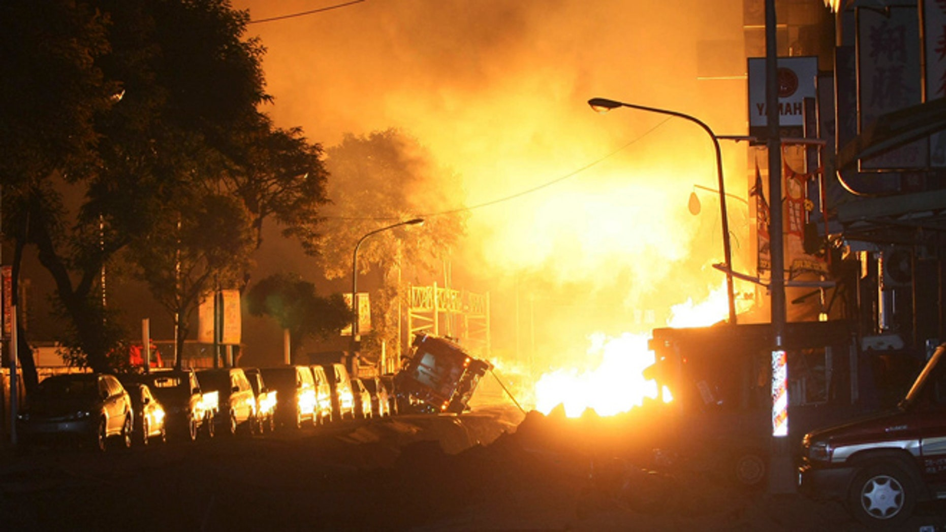 Aug. 1, 2014: Flames from an explosion from an underground gas leak in the streets of Kaohsiung, Taiwan.