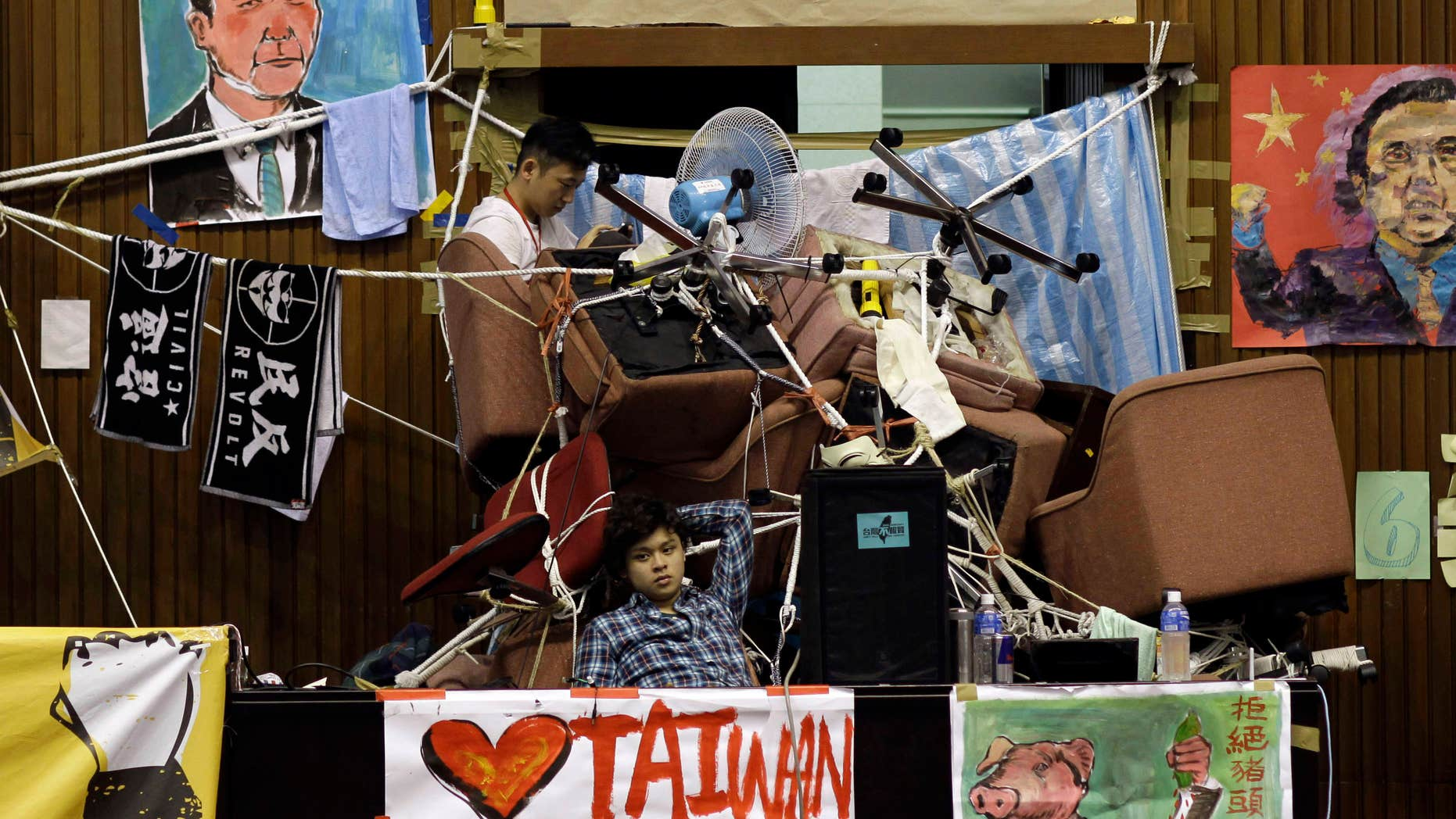 March 28, 2014:  Student protesters against a pro-China trade pact continue to occupy the legislature floor in Taipei, Taiwan.