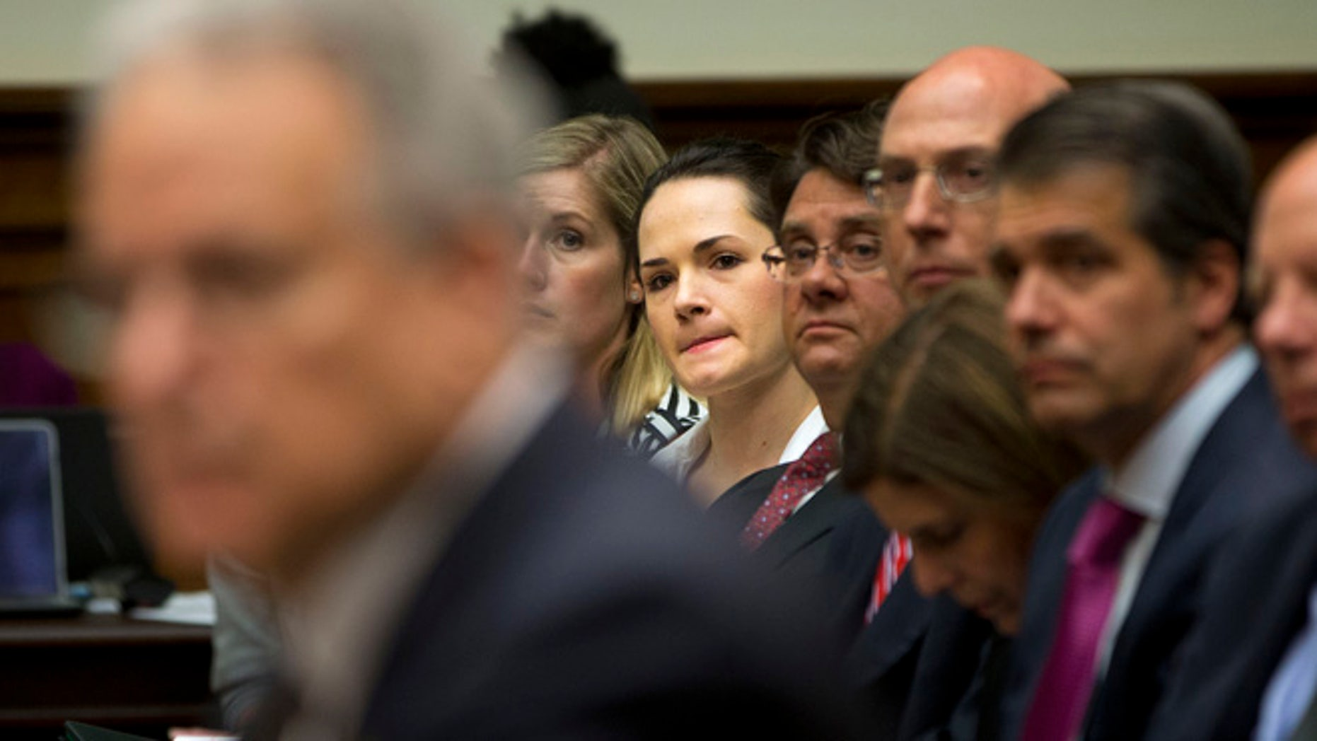 June 2, 2015: Angelina Sujata, center, a victim of a defective Takata airbag, listens to testimony on Capitol Hill in Washington.