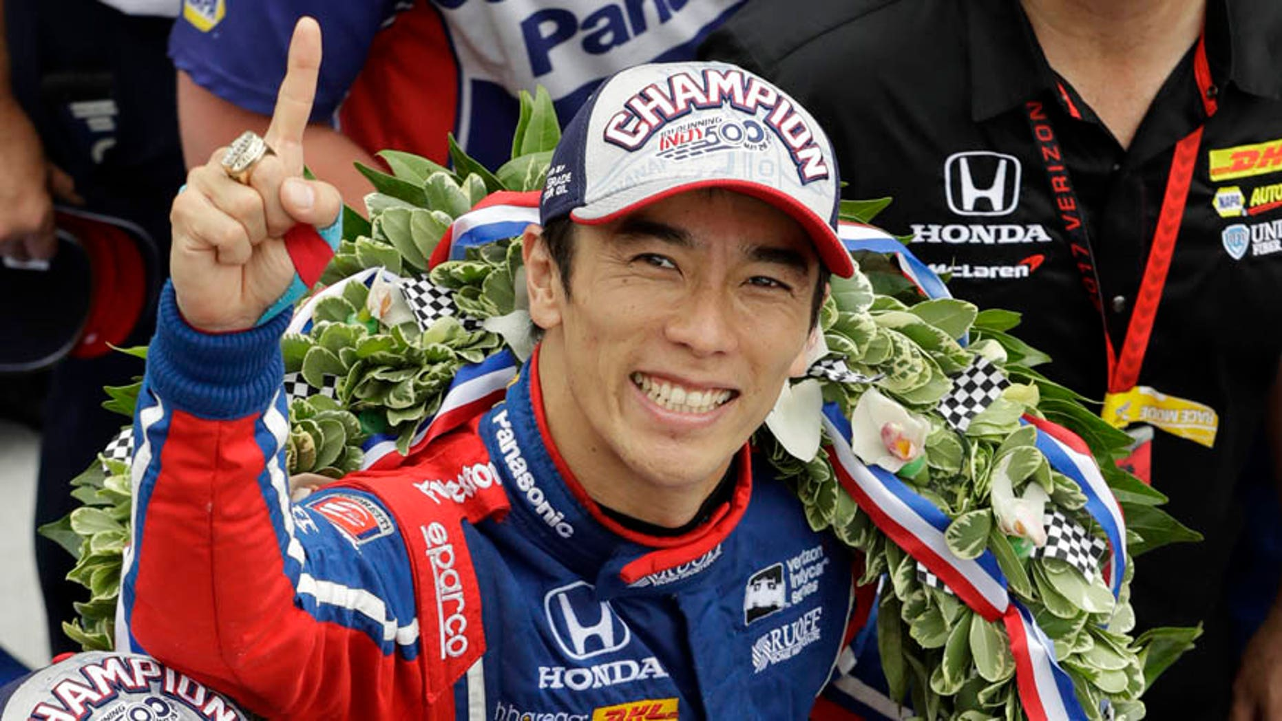 May 28, 2017: Takuma Sato, center, of Japan, celebrates after winning the Indianapolis 500 auto race at Indianapolis Motor Speedway in Indianapolis.