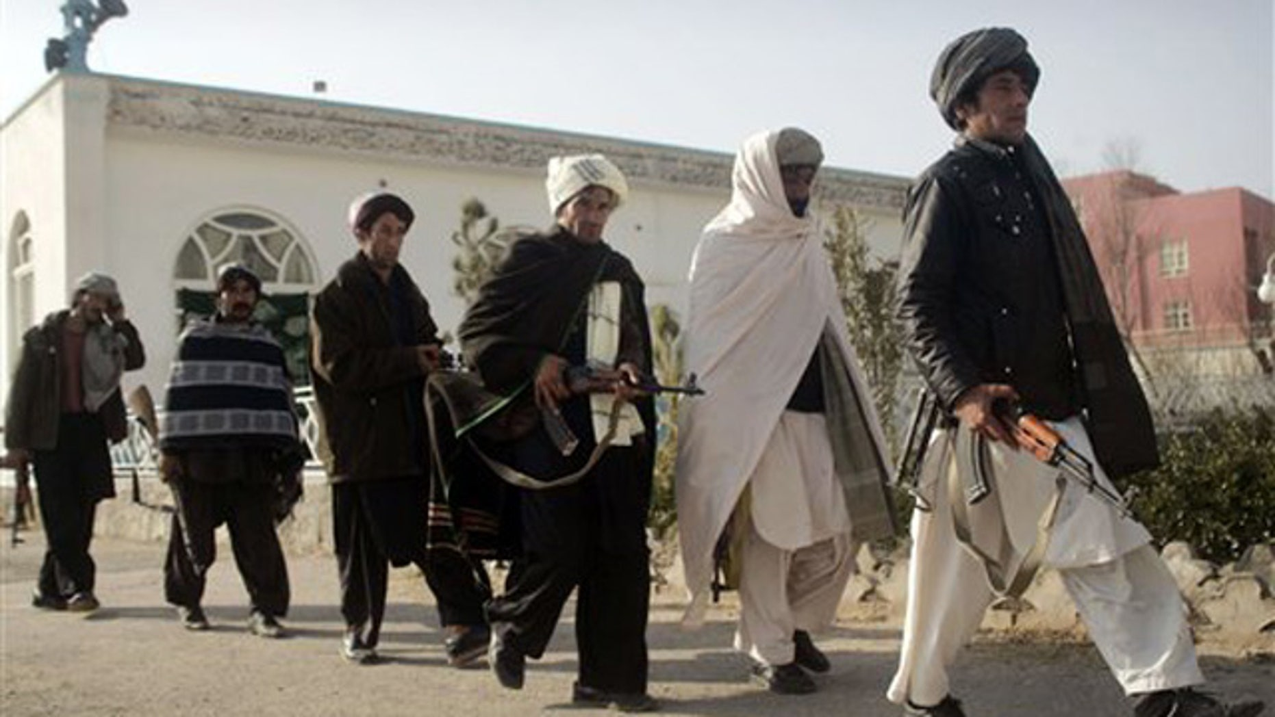 Dec. 28, 2011: Former Taliban  militants walk to hand over their weapons during a joining ceremony with the Afghan government in Herat, Afghanistan.