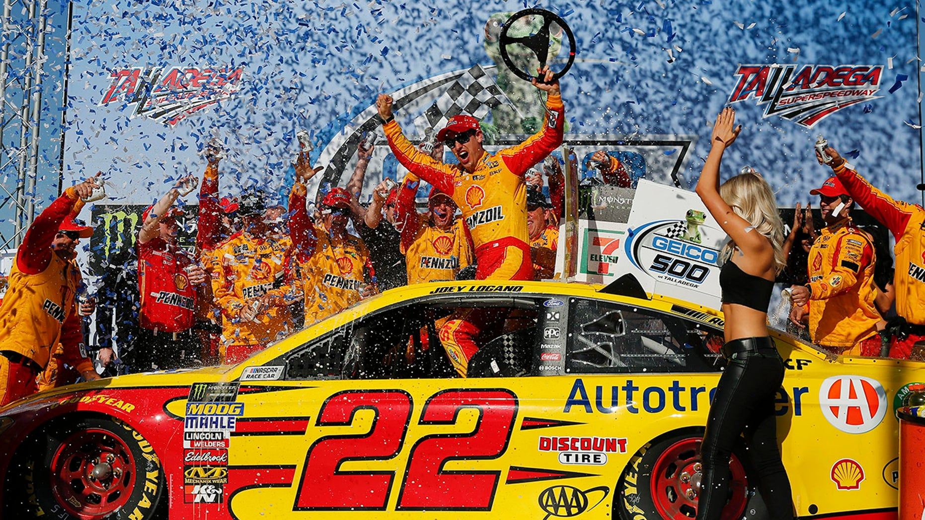 NASCAR driver Joey Logano celebrates in victory lane after winning the NASCAR Talladega auto race at Talladega Superspeedway, Sunday, April 29, 2018, in Talladega, Ala. (AP Photo/Brynn Anderson)