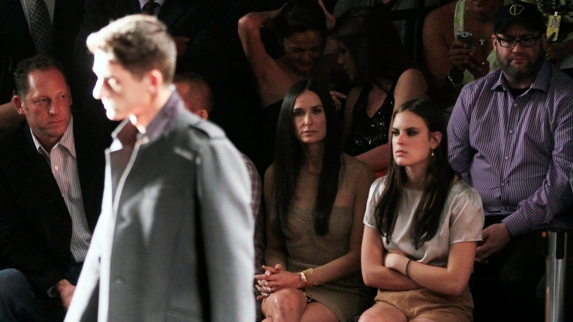 January 30, 2011. Demi Moore (L) and her daughter Tallulah Willis watch the Colcci's collection show during Sao Paulo Fashion week Winter 2011 in Sao Paulo, Brazil.