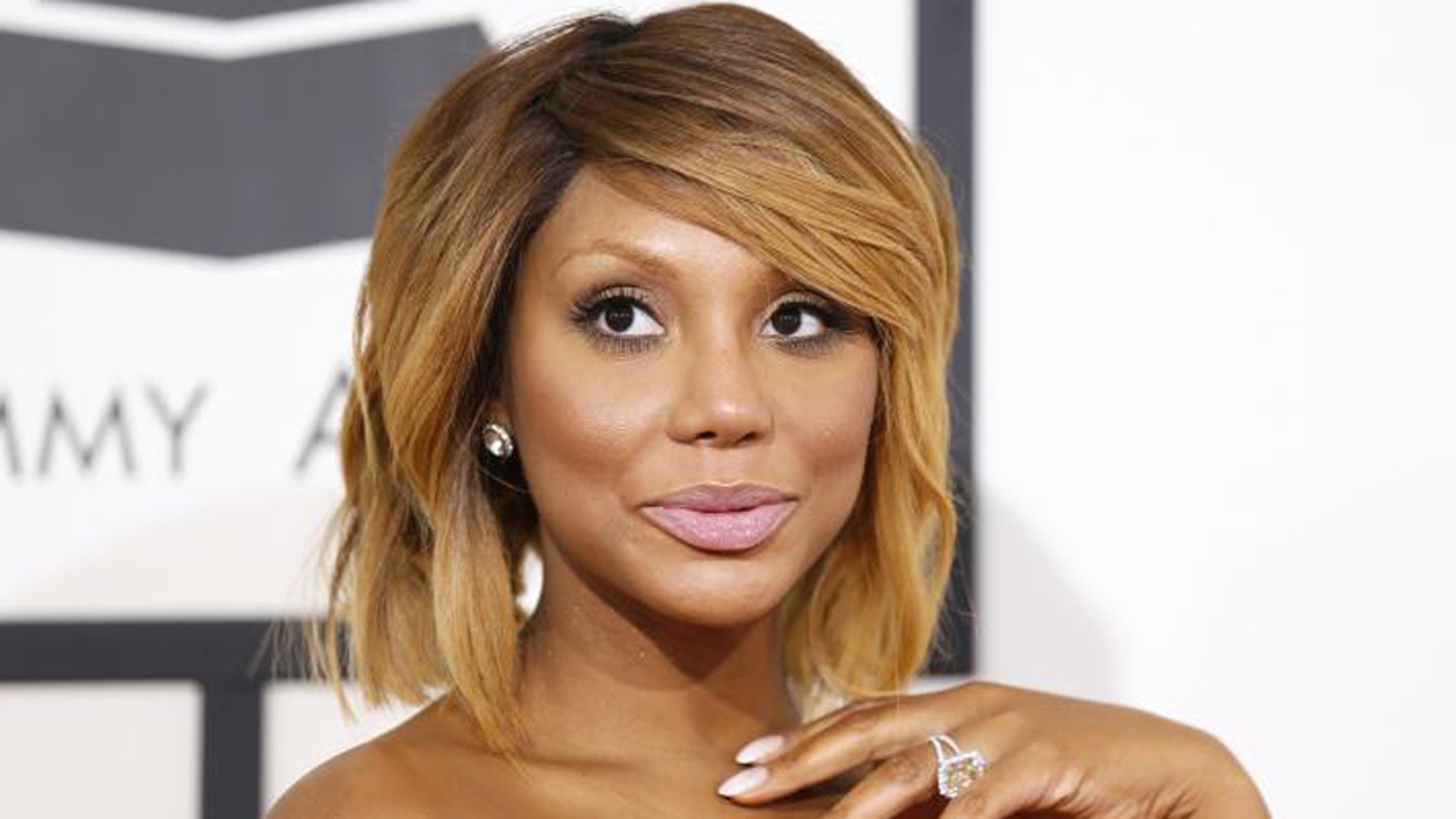 R&B artist Tamar Braxton arrives at the 56th annual Grammy Awards in Los Angeles, California January 26, 2014.