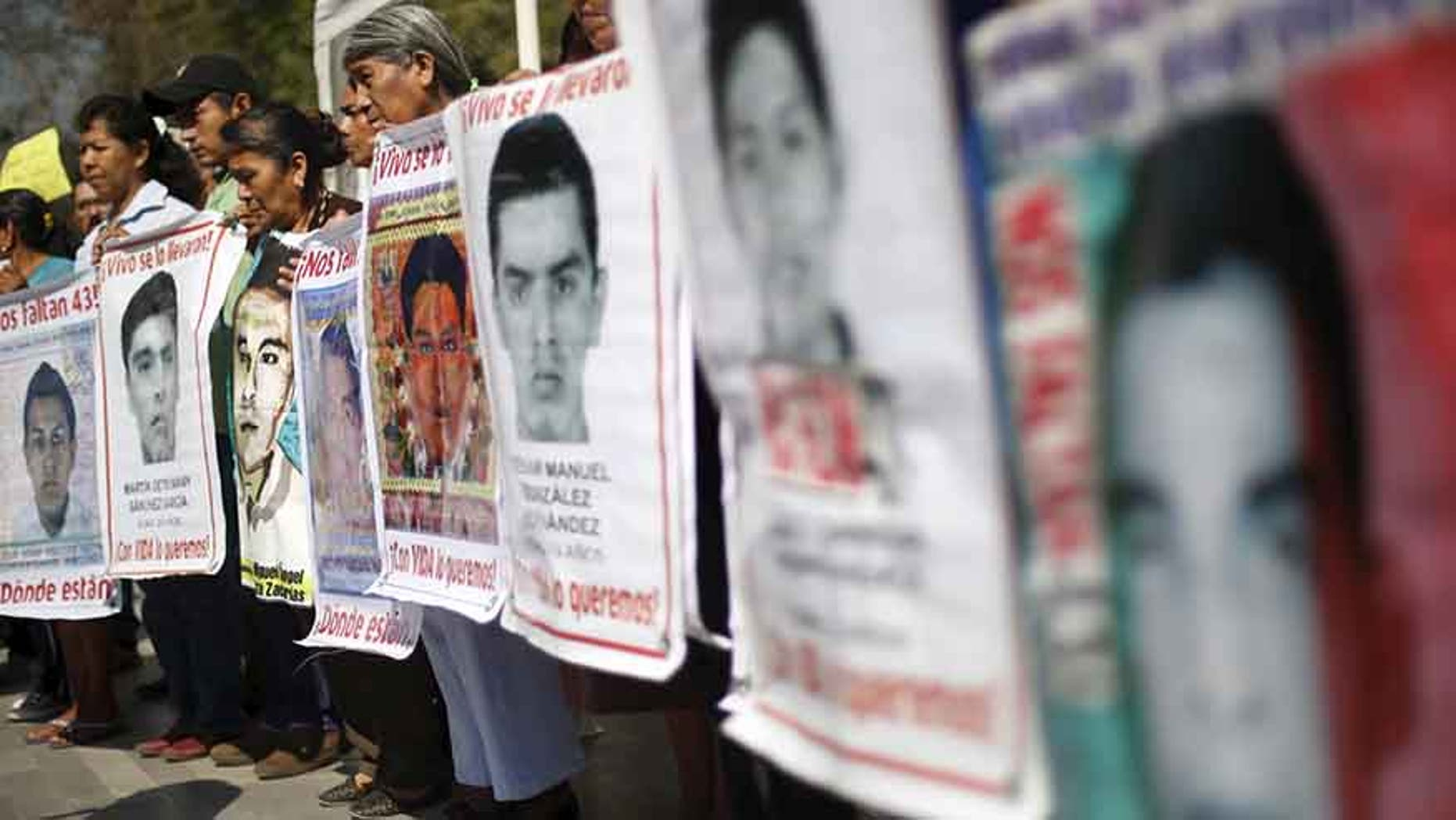 Relatives of the 43 students missing from Ayotzinapa take part in a demonstration in Mexico City, on Feb. 22, 2016.