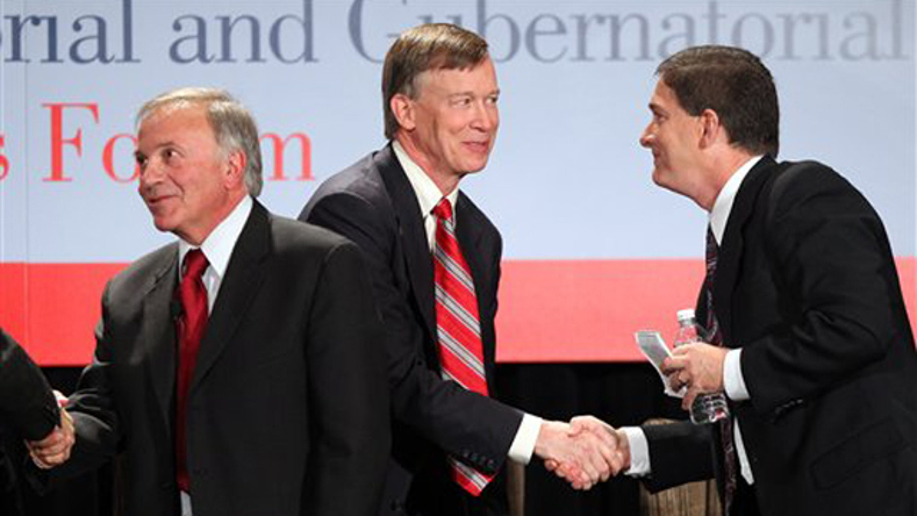 Colorado gubernatorial candidates Tom Tancredo, left, American Constitution Party, Democrat John Hickenlooper, center, and Republican Dan Maes exchange hand shakes after a forum in Denver on Oct. 15. (AP Photo)