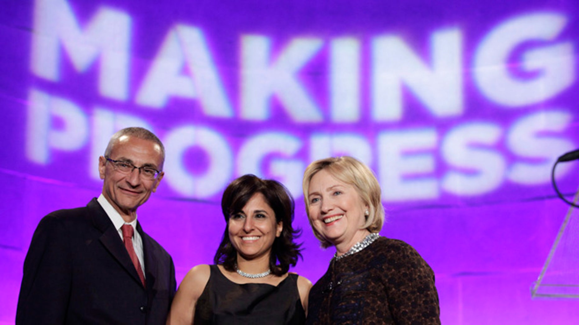 FILE: October 24, 2013: Hillary Clinton (r) with President of the Center for American Progress Neera Tanden and CAP founder John Podesta, Washington, D.C. REUTERS
