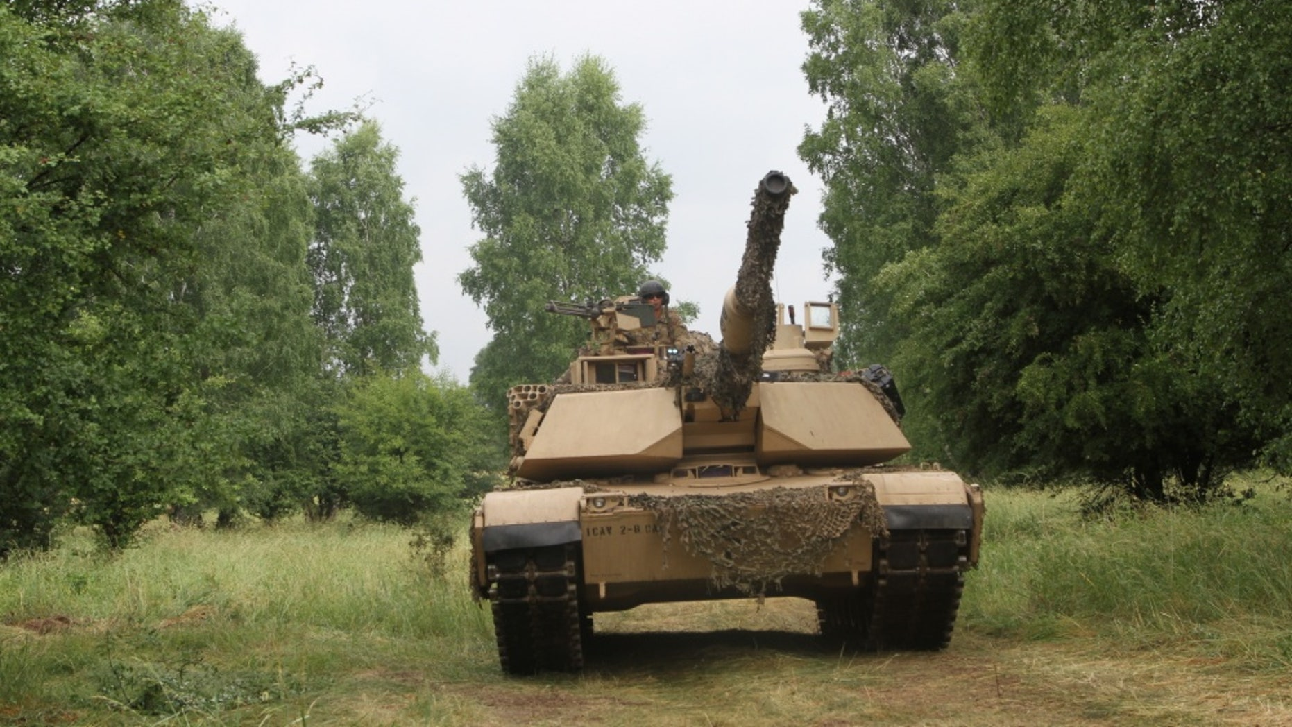 "File photo - Tank crewmen from Bravo Company ""Eager Arms"", 2nd Battalion, 8th Regiment, 1st Armored Brigade Combat Team, 1st Cavalry Division maneuver a M1A2 Abrams tank during a training exercise in Poland, on June 12, 2018. (U.S. Army National Guard photo by Staff Sgt. Ron Lee, 382nd Public Affairs Detachment, 1ABCT, 1CD/Released)"