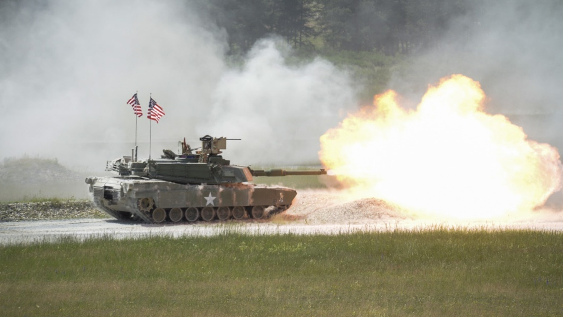 File photo - A United States M1A2 SEP fires it's main gun during the shoot-off of Strong Europe Tank Challenge.U.S. Army Europe and the German Army co-host the third Strong Europe Tank Challenge at Grafenwoehr Training Area, June 3 - 8, 2018.  U.S. Army Photo by Kevin S. Abel)