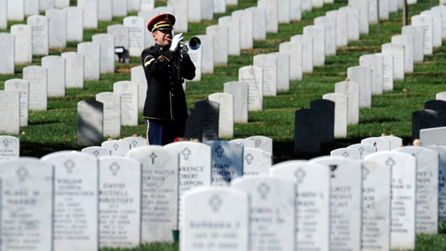 A bugler plays 'Taps' during the 2009 funeral for Army Spc. Stephen Mace at Arlington Cemetery in Arlington, Va. Due to a looming budget cut on Oct. 1, virtually all military funerals in New York state will use an electronic bugle instead of a live performance. (AP)