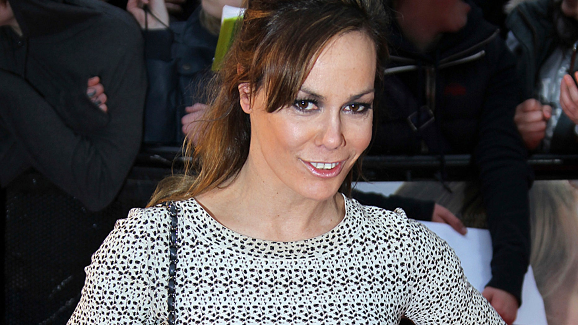 A Monday, April 23, 2012 file photo of British socialite and goddaughter of Britain's Prince Charles, Tara Palmer-Tomkinson arriving for the European Premiere of 'The Lucky One' at the Bluebird restaurant in London.