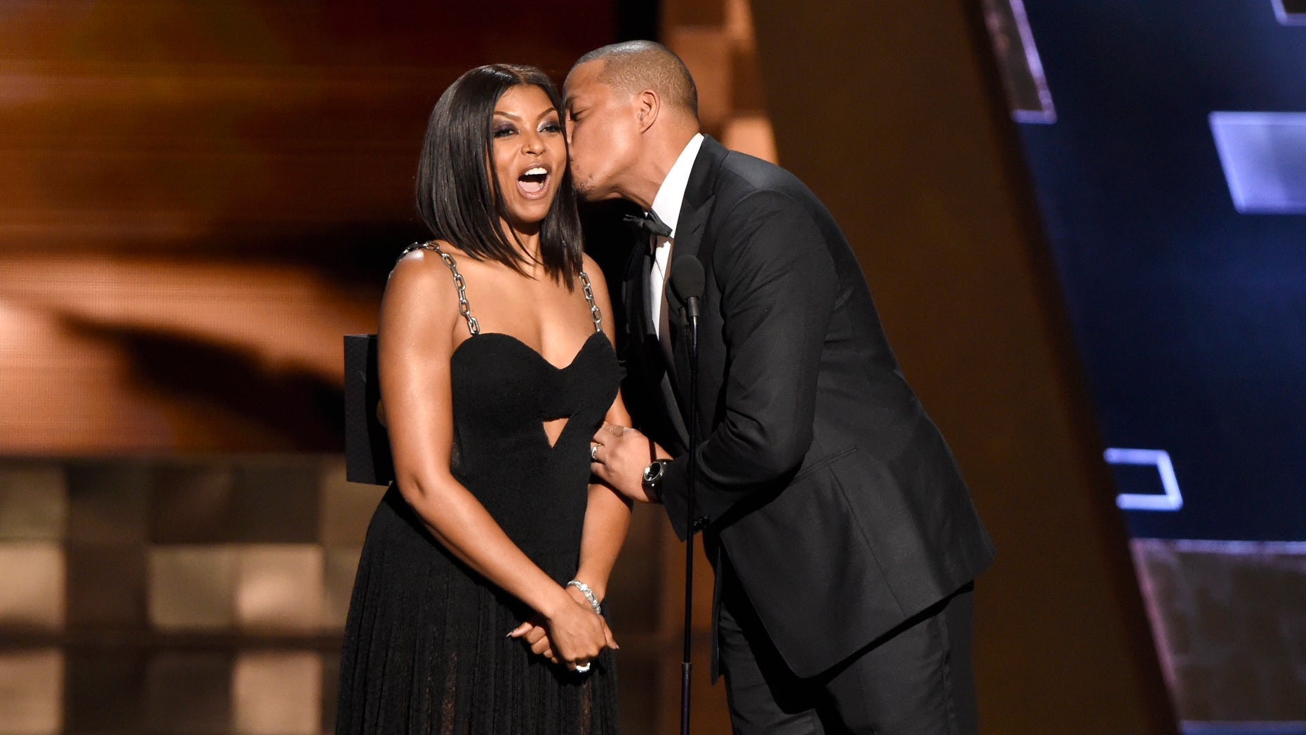 Taraji P. Henson, left, receives a kiss from Terrence Howard as they present the award for outstanding supporting actress in a limited series or a movie at the 67th Primetime Emmy Awards on Sunday, Sept. 20, 2015, at the Microsoft Theater in Los Angeles. (Photo by Chris Pizzello/Invision/AP)