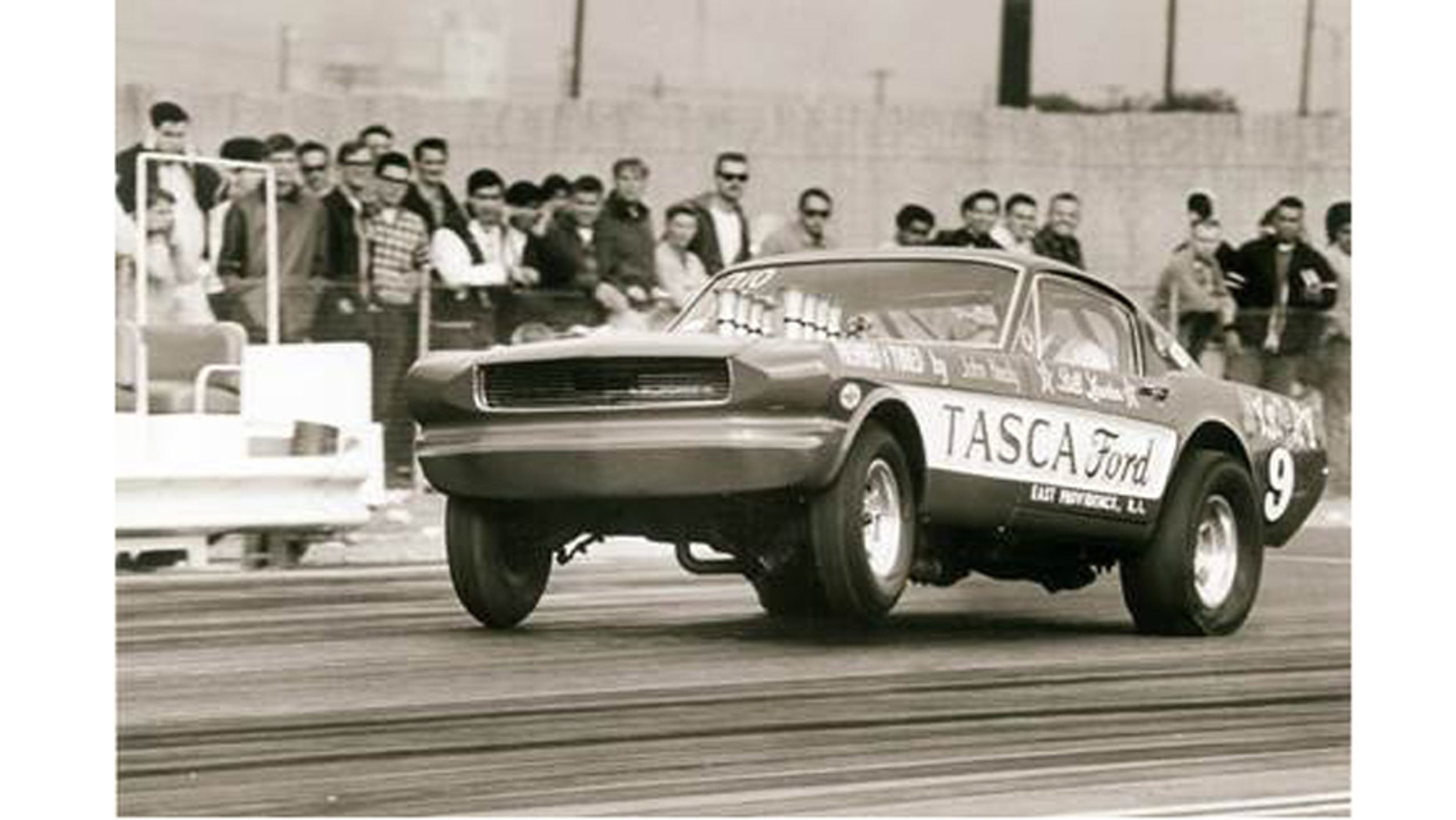"The Tasca Mystery 9 altered-wheelbase Mustang takes a bite of California's Irwindale Raceway at the 1966 AHRA Winternationals with more than 600-hp worth of Hillborn-injected Ford 427 SOHC ""cammer"" V-8 authority."