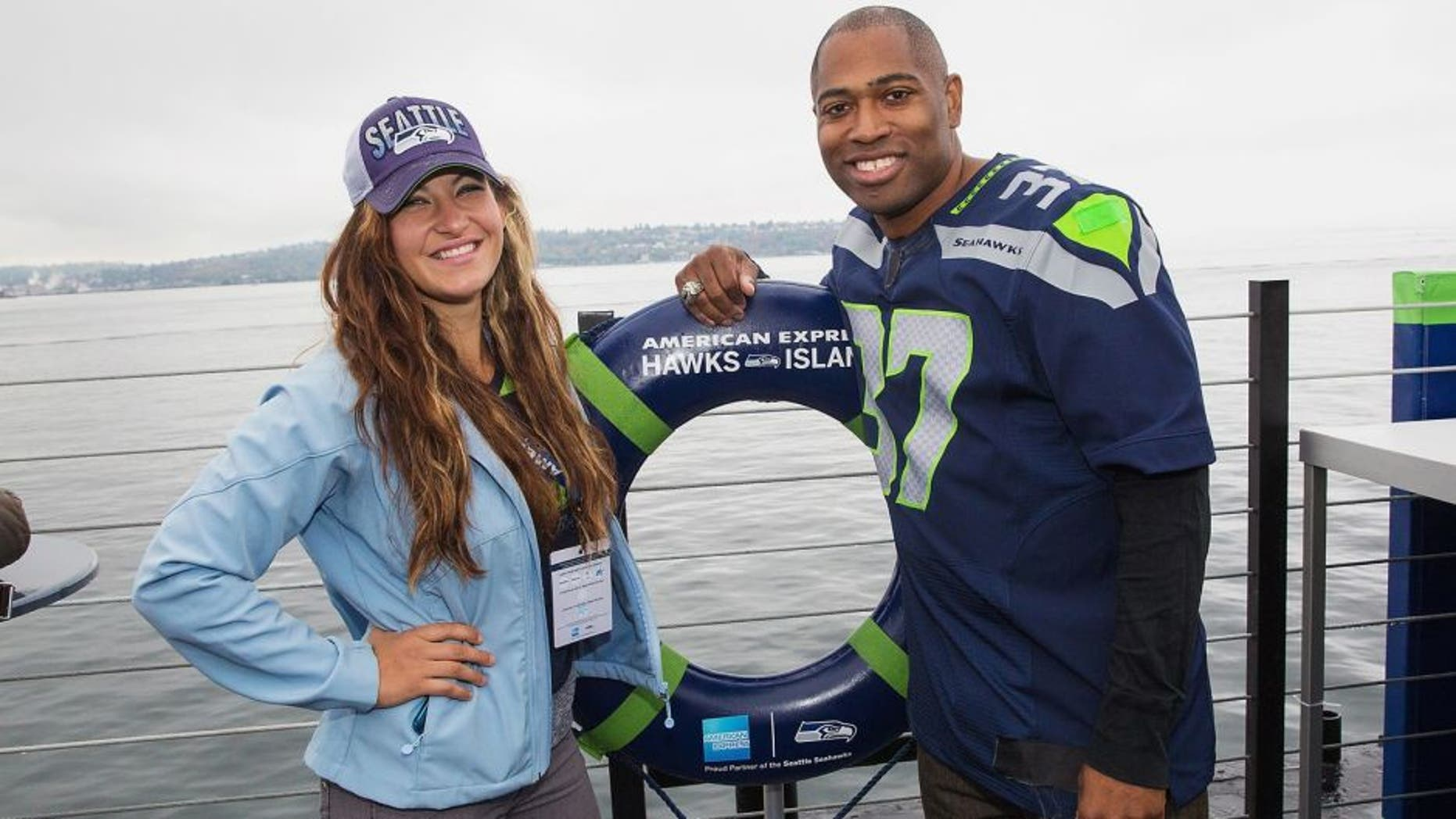 SEATTLE, WA - OCTOBER 18: UFC Mixed Martial Arts Fighter Miesha Tate and Seattle Seahawks Legend Shaun Alexander attend the American Express hosted, never-before-seen pre-game experience for Seattle Seahawks fans and Card Members called American Express Hawks Island on a barge on the Puget Sound. on October 18, 2015 in Seattle, Washington. (Photo by Mat Hayward/Getty Images for American Express)