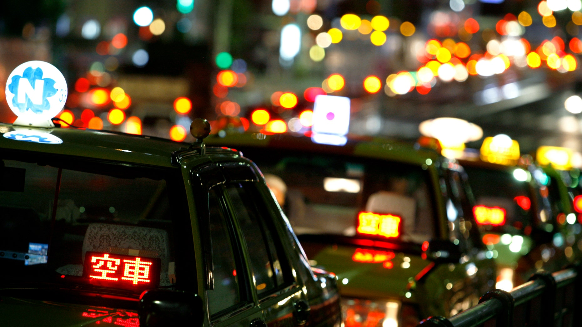 File photo - Taxis are parked as drivers wait for customers on a road in Tokyo Aug. 3, 2009. (REUTERS/Stringer)