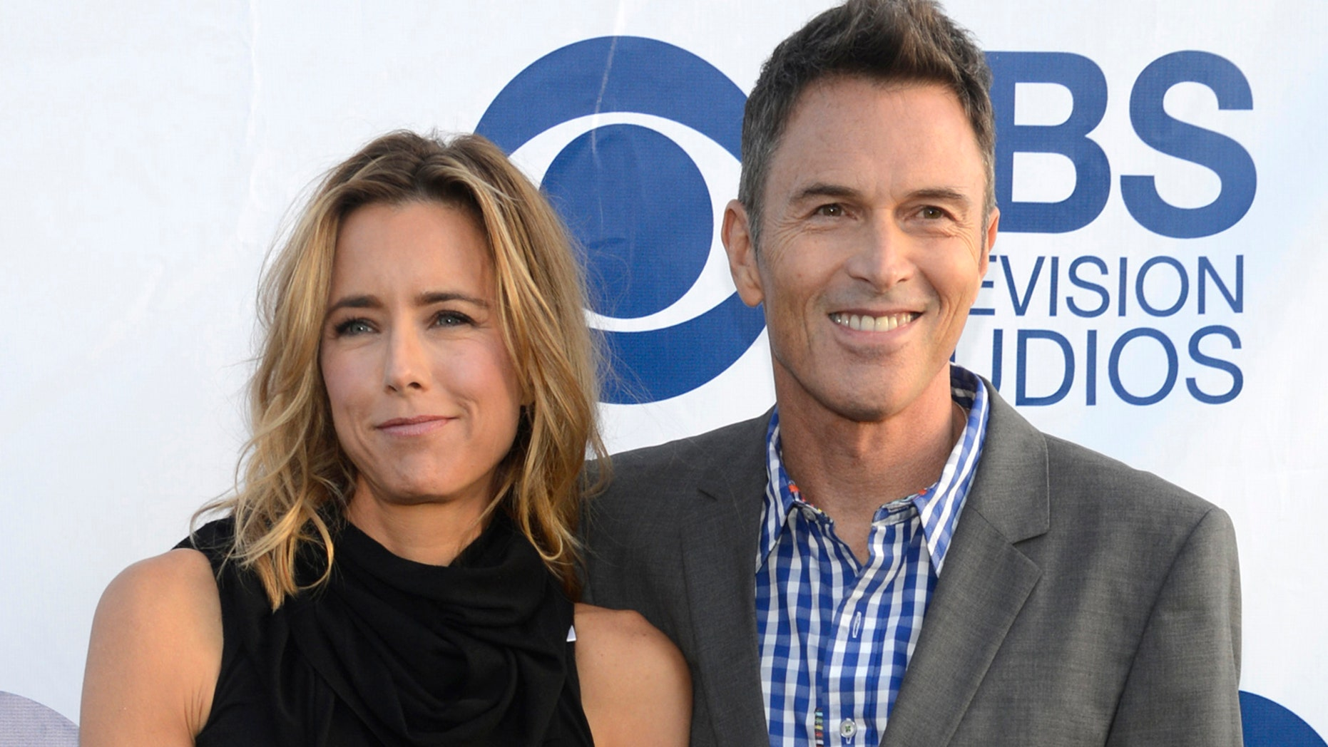 """Tea Leoni (L) and Tim Daly attend the CBS Television Studios """"Summer Soiree"""" in West Hollywood, California May 19, 2014."""