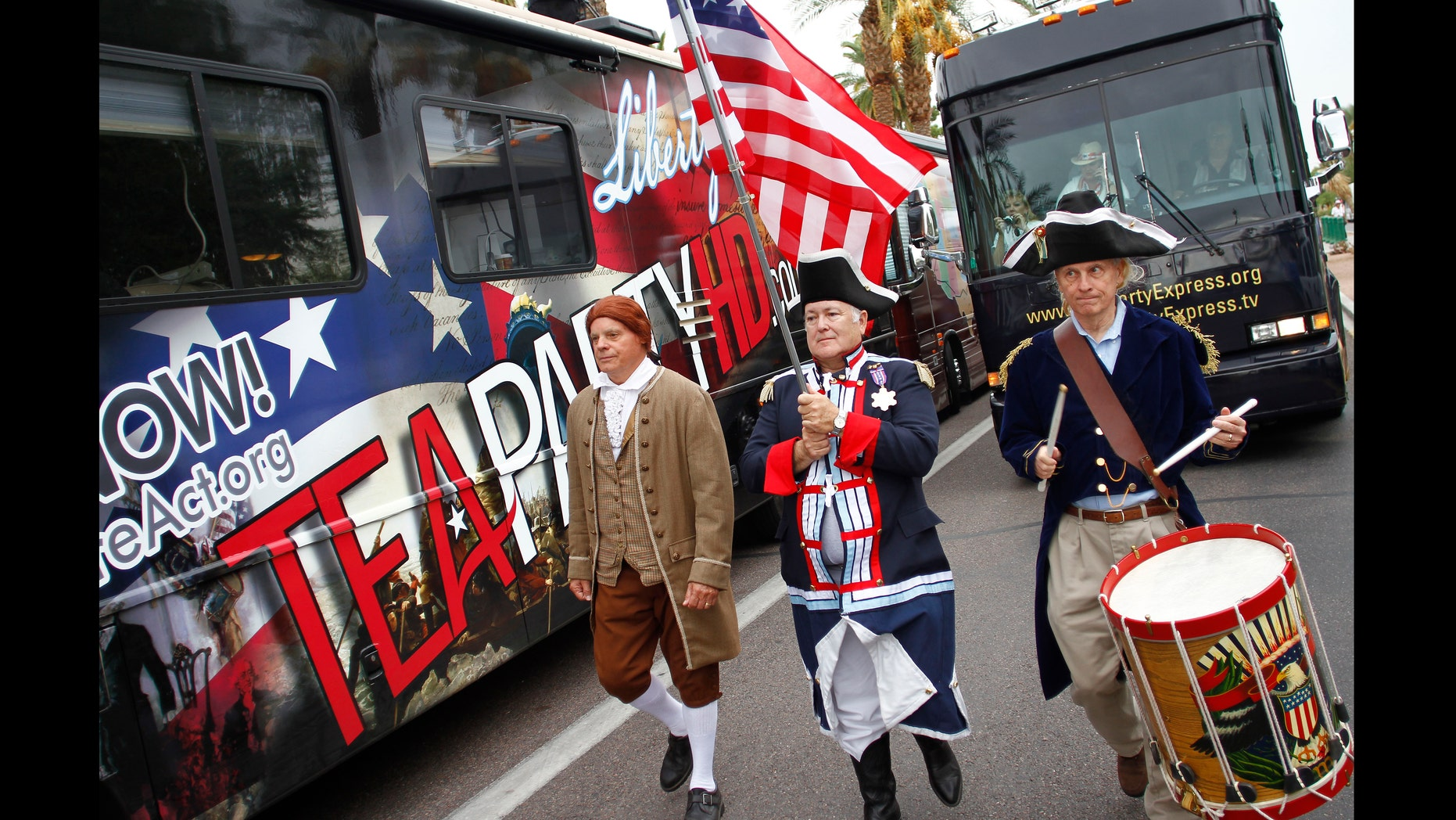 PHOENIX, AZ -  OCTOBER 22:  (L-R) Doctor Lance Hurley, John Rosado and Mitch Markovich wear colonial style attire as they march during the rally for the Tea Party Express national tour October 22, 2010 in Phoenix, Arizona. The tour, part of an initiative to get conservatives elected to the House and Senate, will move across country and conclude on November 1, 2010 in Concord, New Hampshire the day before the contentious mid-term elections. (Photo by Joshua Lott/Getty Images)