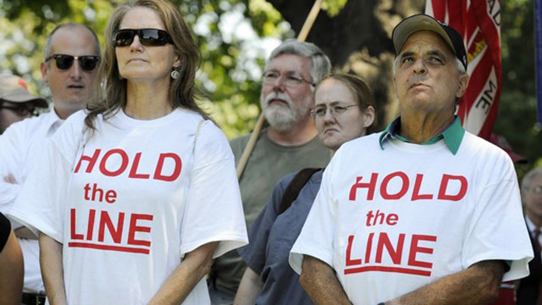FIle: Tea Party supporters wear 'Hold the Line' t-shirts as dozens rallied near the U.S. Capitol against raising the debt limit in Washington July 27.