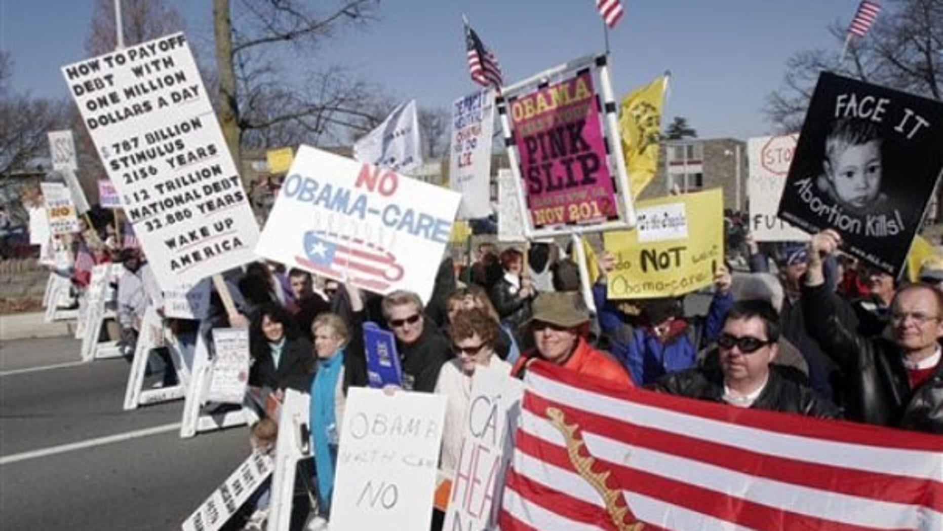 Monday: Tea Party supporters demonstrate before the arrival of President Obama in Glenside, Pa. (AP Photo)
