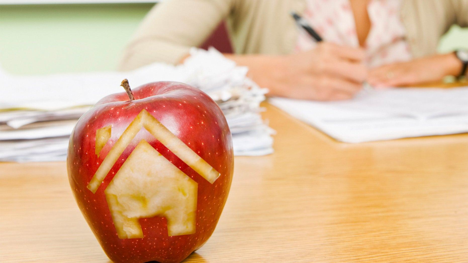 house carved into teacher's apple