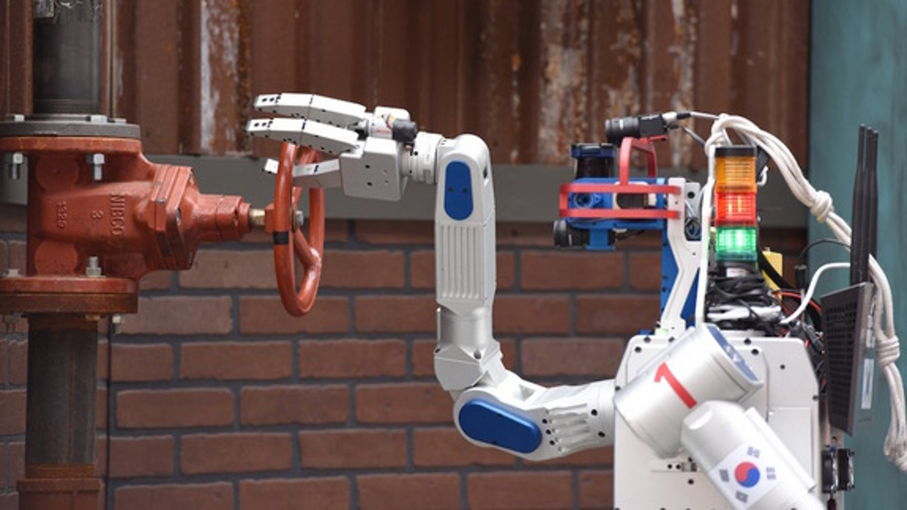 The robot from South Korean Team KAIST swept the field at the DARPA Robotics Challenge, successfully completing all tasks in the least amount of time.