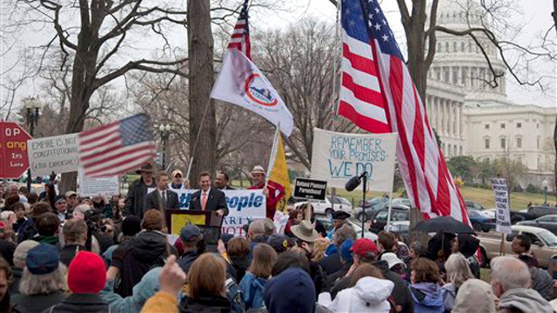 Sen. Jim DeMint, at podium, addresses a Tea Party rally March 31 on Capitol Hill.
