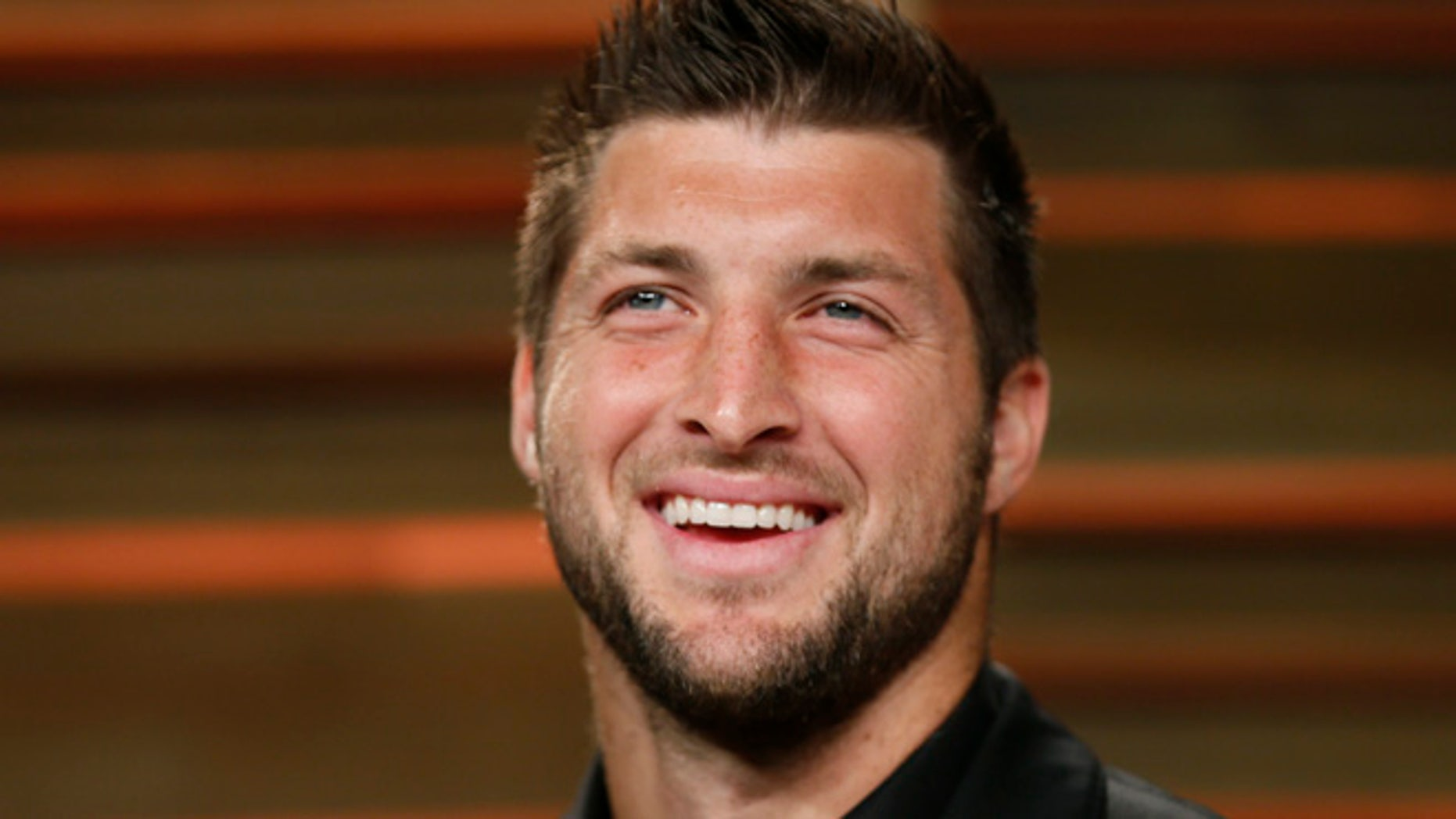 Mar. 2, 2014; Former NFL player Tim Tebow arrives at the 2014 Vanity Fair Oscars Party in West Hollywood, California.