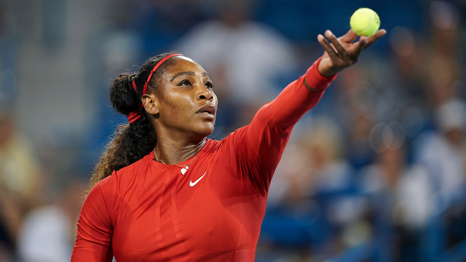 Serena Williams serves to Petra Kvitova, of the Czech Republic, at the Western & Southern Open tennis tournament.
