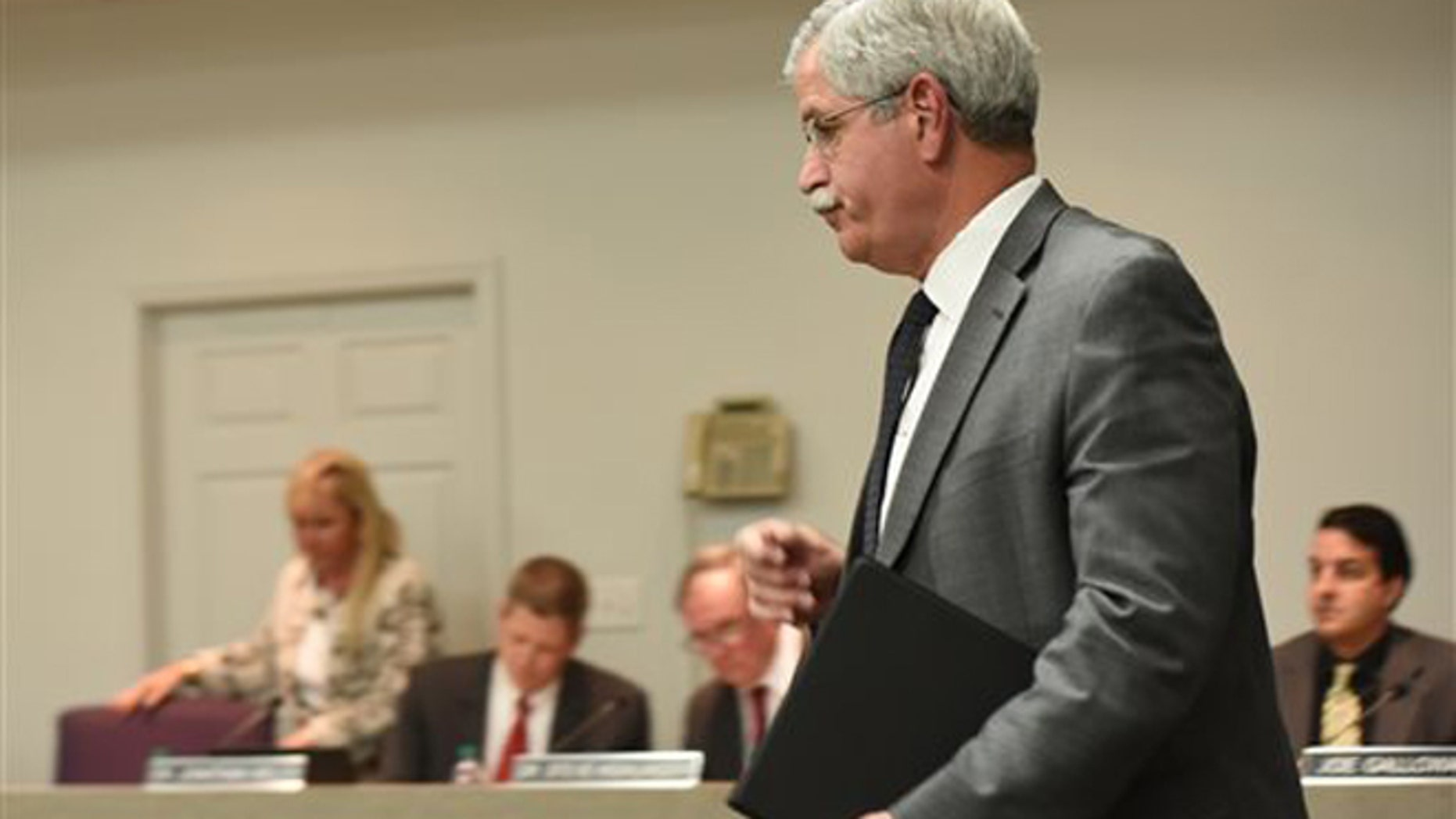 Hamilton County Schools Superintendent Rick Smith enters a school board meeting room before a short public meeting in Chattanooga, Tenn., Wednesday, Jan. 6, 2016.