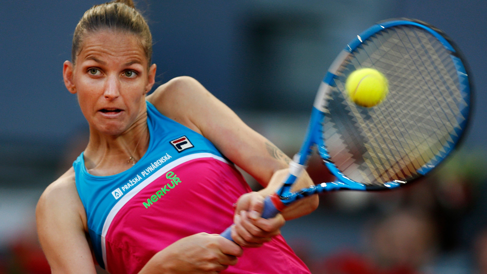 Karolina Pliskova from Czech Republic returns a ball from Czech Republic's Petra Kvitova during a Madrid Open tennis tournament semifinal match in Madrid, Spain