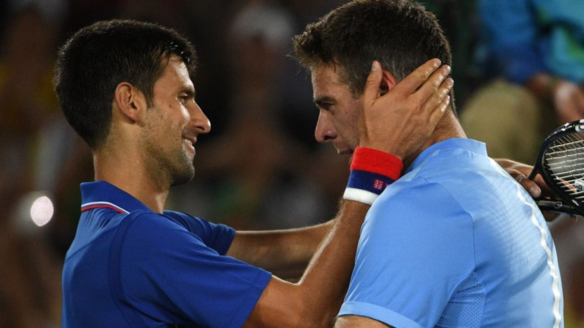 Argentina's Juan Martin del Potro (R) speaks to Serbia's Novak Djokovic after winning their men's first round singles tennis match at the Olympic Tennis Centre of the Rio 2016 Olympic Games in Rio de Janeiro on August 7, 2016. / AFP / Roberto SCHMIDT (Photo credit should read ROBERTO SCHMIDT/AFP/Getty Images)