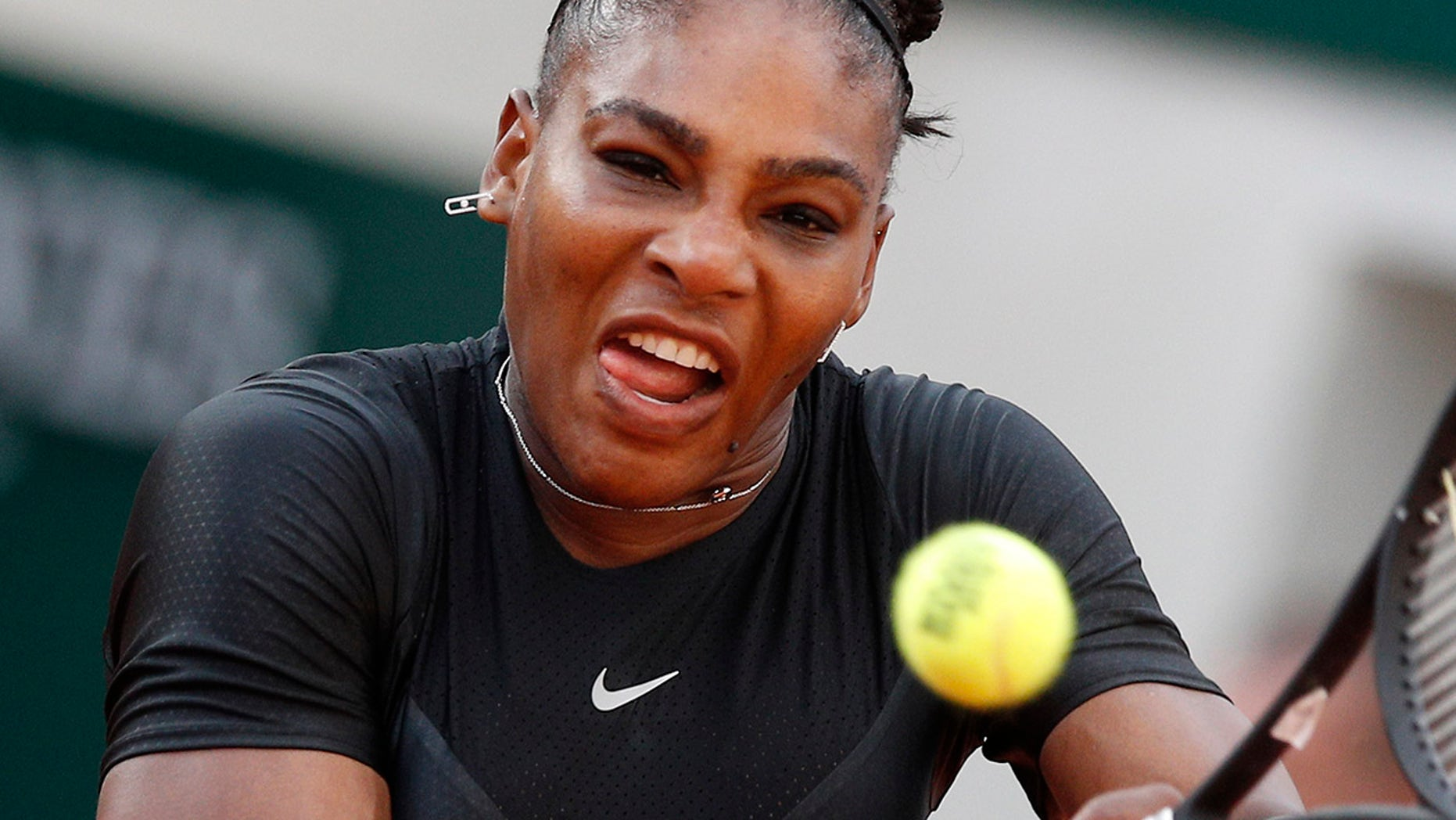 Serena Williams of the U.S. returns a shot against Germany's Julia Georges during their third round match of the French Open tennis tournament at the Roland Garros stadium in Paris.